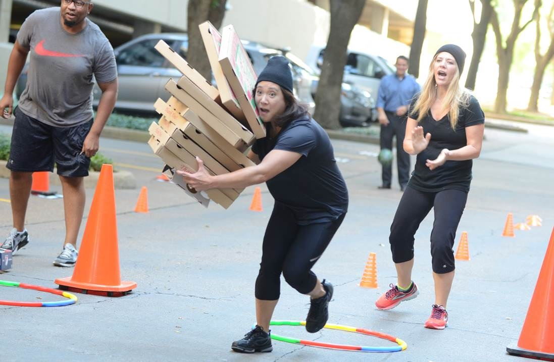 Woman running with pizza boxes